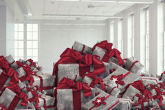 Mountain of gift boxes. Mixed media. Big pile of Christmas gifts as symbol for coming holiday. Mixed media Stock Photography