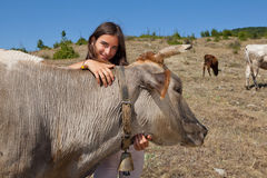 Mountain girl with cattle Royalty Free Stock Images
