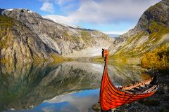 Norway Mountain Glacial Lake Boat. Mountain glacial lake and boat in summer. Norwegian fjord. Arctic circle, Norway royalty free stock photo