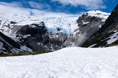 Mountain with glacier in Norway. And snow in foreground Royalty Free Stock Photo