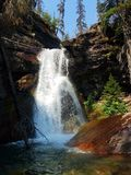 Rocky Mountain Water fall 4k with glaciers in the summer. Mountain glacier park green waterfall valley glaciers Stock Photos