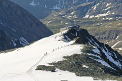Mountain and glacier path. Photo taken during ascent of Grossglockner, the highest summit of Austria, The Hohe Tauern national park. Above Johann refuge. Summer Stock Images