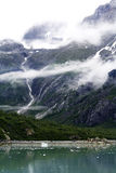 Mountain Glacier Rivulet with Whispy Clouds Royalty Free Stock Photos