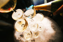 Mountain glasses of champagne. A bottle of stream stock images