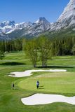 Mountain Golf Course. Golfers enjoy the Kananaskis Golf Course in the Canadian Rockies royalty free stock photos