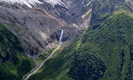 Mountain gorge. Dombay. Stream in a mountain gorge. Dombay the Republic of Karachay-Cherkessia in the North Caucasus, Russia. Photo taken on: July 26 Friday Royalty Free Stock Image