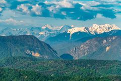 Mountain gorge with high mountains with snowy peaks. Dramatic cloudy sky over a mountain canyon stock photo