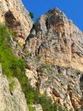 Mountain gorges and mountains. View of the blue sky. Summer. royalty free stock photos