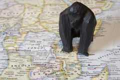 Mountain gorilla statue on map of Africa Stock Photos