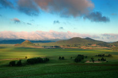 Mountain & grassland. Green spring field in the morning stock photos