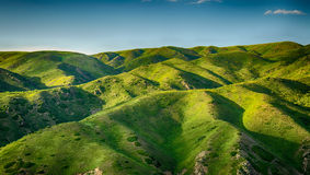 Mountain with grassland Stock Images