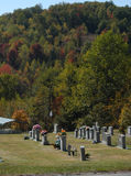 Mountain graves. A cemetary near a small mountain Royalty Free Stock Images