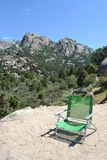 Mountain, green chair in foreground Royalty Free Stock Photo