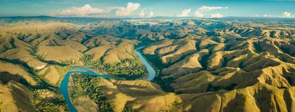 Mountain green hills panorama with curvy river royalty free stock image