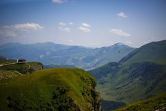 Mountain green valley with a deep gorge, high mountains and hills covered with grass royalty free stock photography