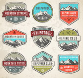 Mountain Grunge color Vector insignias Stock Photography