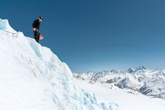 Mountain guide candidate training ice axe and rope skills on a glacier in the North Caucasus royalty free stock photo