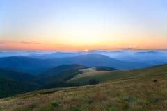 Mountain hazy daybreak Stock Photos