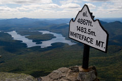 Mountain Height Signpost. A sign on the top of a mountain indicating its height of 4867 feet Royalty Free Stock Photography