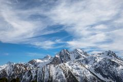Mountain high ridge in the snow during the day in sunny weather stock image
