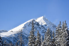 A mountain in High Tatras in Slovakia covered in snow. On a beautifull sunny day Stock Image