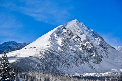 A mountain in High Tatras in Slovakia covered in snow Stock Photos