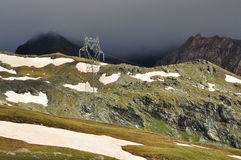 Mountain high voltage pylon, Italian Alps. Royalty Free Stock Photography