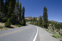 Mountain Highway. A scenic scene of a road leading through the mountains under a deep blue sky Stock Image