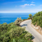 Mountain highway with blue sky and sea. On a background Stock Photo