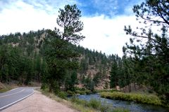 Mountain highway curving with a river. royalty free stock images