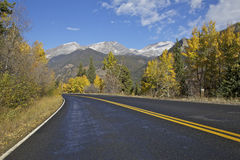 Mountain Highway in Fall. A highway winds through a scenic landscape in the colorado rocky mountain in fall Stock Photo