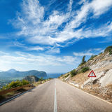 Mountain highway perspective with dramatic sky Stock Image