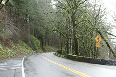 Mountain highway. A mountain road going through forest Royalty Free Stock Photography