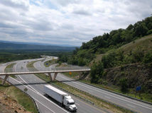 Mountain Highway. Semi driving on a highway around a mountain royalty free stock photos