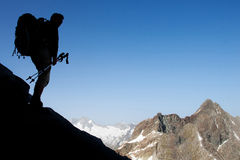 Mountain hiker. Silhouette of mountain hiker with large copy space Stock Image
