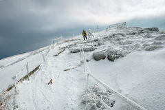 Mountain hiker in bad weather Royalty Free Stock Photography
