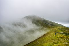 Mountain hiker  in clouds Royalty Free Stock Photos
