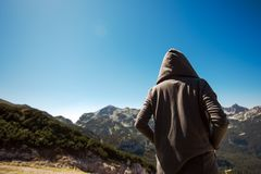 Mountain hiker at high viewpoint looking at the valley Royalty Free Stock Image