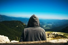 Mountain hiker at high viewpoint looking at the valley Royalty Free Stock Photos