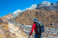 Mountain Hiker walking with Backpack and Solar Battery royalty free stock images