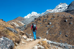 Mountain Hiker walking with Backpack and Solar Battery stock image