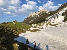 Mountain hikers in the Appenzellerland region and Alpstein mountain range stock photography
