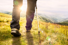 Mountain hiking. Lens flare, shallow depth of field Royalty Free Stock Image