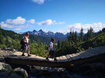 Mountain hiking, people walking on bridge