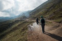 Mountain hiking in Peru. VINICUNCA, PERU - OCTOBER 29: tourists hiking by altitude mountain trail near Vinicunca area, Peru on October 29, 2018 stock photos