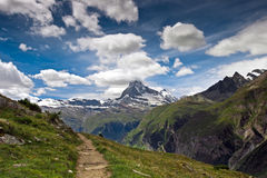 Mountain hiking road. With beautiful Matterhorn view Stock Image