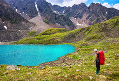 Mountain hiking. Woman and pristine Siberian nature stock images