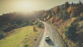 Mountain hill country road car drive aerial view stock photos