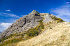 Mountain hill under blue sky. Stock Image