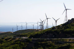 Mountain hills with wind turbines generating electricity Royalty Free Stock Photo